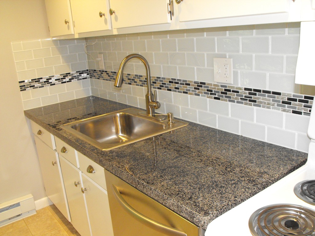 Glass Subway Tile Backsplash with Glass Mosaic Accent Row